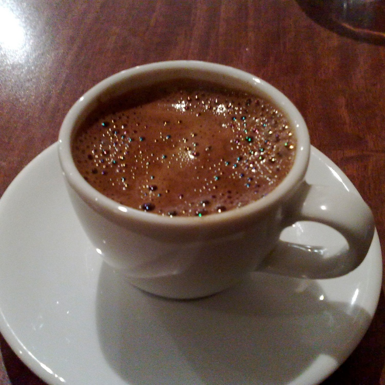 The author has positive attitudes towards drinking coffee incessantly. But other factors (i.e. budgetary concerns and the biological need for sleep) limit him to 1-2 cups a day. Turkish Coffee by Secretlondon123. CC BY-SA 2.0