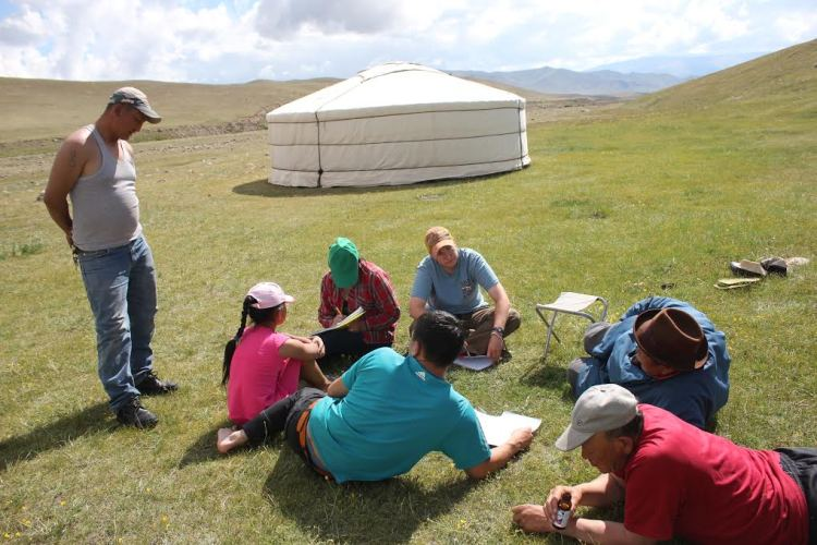 Katey speaks with herders in Mongolia. Image courtesy Katey Duffey.