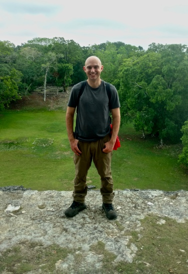 Standing on top of the Jaguar Temple, with the structure known as the Royal Complex behind me.