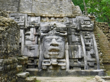 A close-up of the Mayan masks that give the Mask Temple its name.