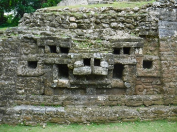 A stylized jaguar face on the ancient Mayan Jaguar Temple in Lamanai, Belize.