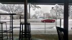 Looking out the window of the Slow Train Cafe, as snowflakes gently fall.