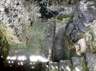 A chamber in Tikal's Main Plaza that was found by accident. The floor is significant, because it is from the Preclassic era.