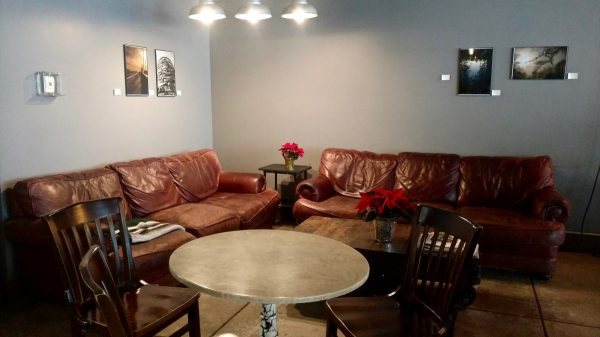 A set of couches in the Slow Train Café.