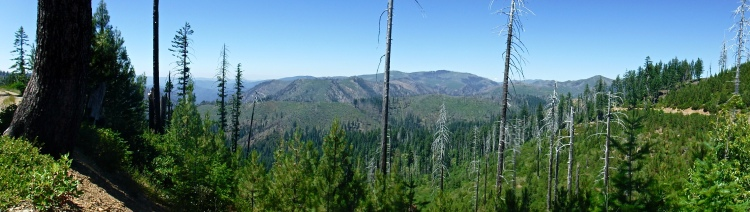 A panorama of green mountains.