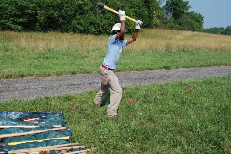 A man using a pick-mattock.