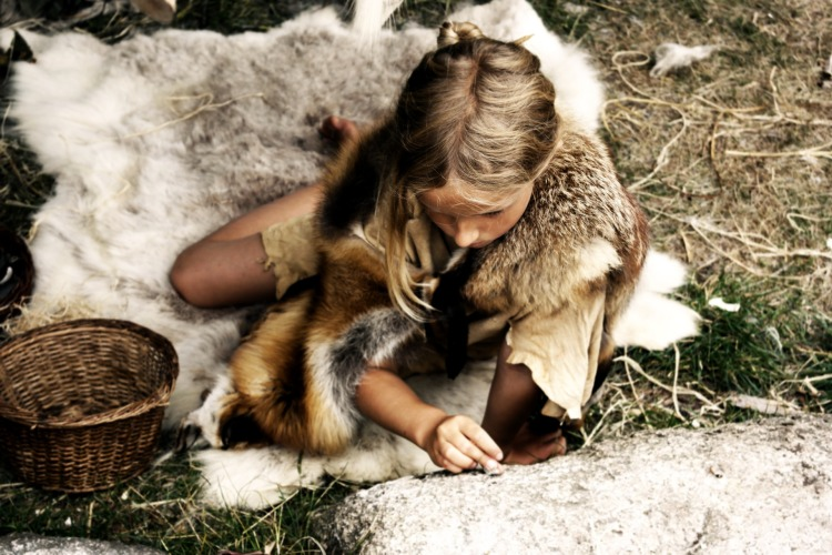 A modern girl in Stone Age clothing.